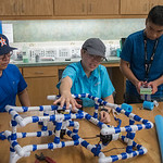 Roman Pena (left), Meagan Saylob, and Vincent Nguyen apply tape to PVC pipe in the Pipe ROV Building workshop during the Summer STEM camp.  To learn more about our STEM summer camps, click h ...