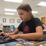 Elaina Guzman(11) tries the laptop during woman in technical workshop.