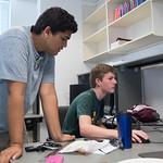 Vedant Chopra (left) mentors Andrew Mistele to do the 3-D modeling via AutoDesk in the CAD design workshop
