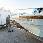 Hugo Mahlke, research engineer for Texas A&M Corpus Christi - University; prepares the trailer hitch to the boat as the Conrad Blucher Institute group departs to install their PORT system of ...