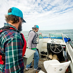 TAMU-CC Conrad Blucher Institute research engineers Hugo Mahlke (left), and Alistair Lord  move a module towards the front of the boat; during their installation of the CCPORTS system off of ...