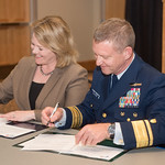 President and CEO, Dr. Kelly Quintanilla (left), and Rear Admiral Paul Thomas, Commander Coast Guard District Eight sign the MOA documents. Tuesday February 20, 2018 in the University Center ...