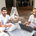 Students Taleb Alalwi and Abdullah Almerdef study outside starbucks
