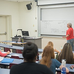 Dr. Stefan Sencerz gives examples of different behaviors during his Introduction to Philosophy course.