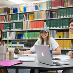 Juliana (left), Kaylee, and Ronnie collaborate on their studies in the @Mary and Jeff Bell Library.