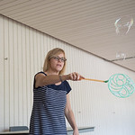 Stefani Schomaker creates bubbles in the Breezeway  at her stress buster table.